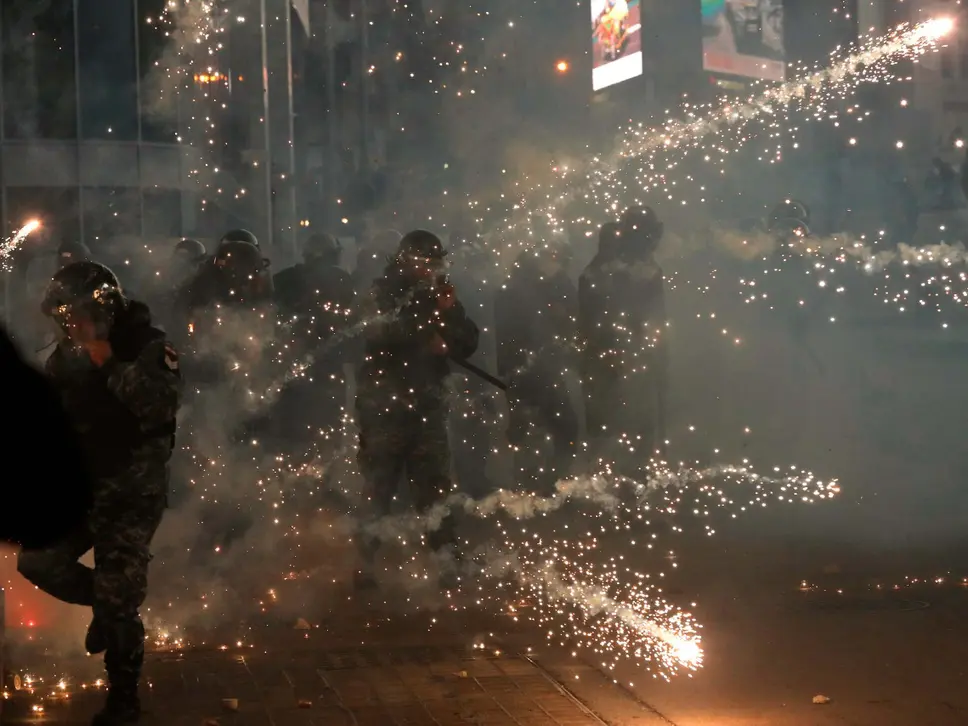 Dozens injured as police fire rubber bullets and water cannons at protesters in Beirut 'The people want to bring down the regime,' demonstrators chant